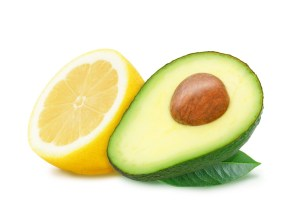 Slices of lemon and avocado with leaves.